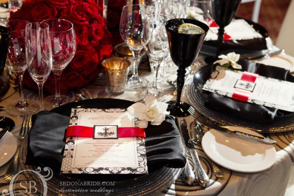 Caprice chose a sparkling table scape of black and silver with red accents